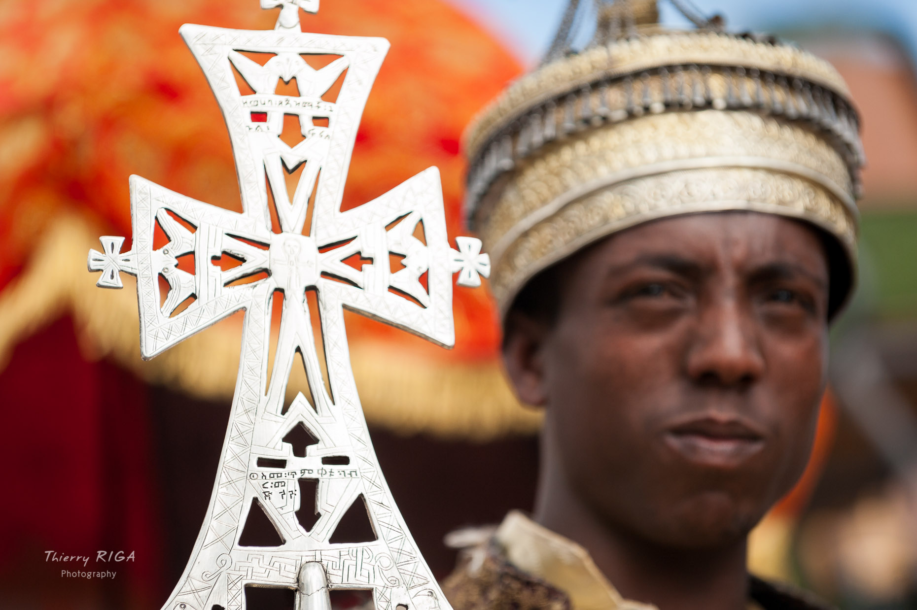 Meskel in Lalibela Ethiopia priest and cross